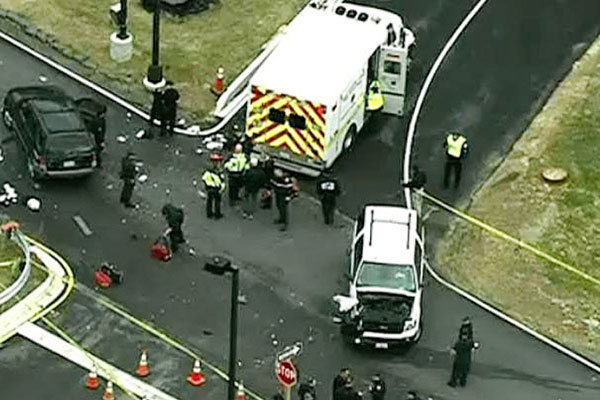In this image made from video and released by WJLA-TV, authorities investigate the scene of a accident near a gate to Fort Meade, Md., on Monday, March 30, 2015. AP Photo/WJLA-TV