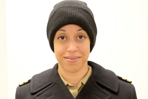 Lt. Jessica Crownover wears the Navy watch cap with reefer jacket with her service uniform. (US Navy Photo)
