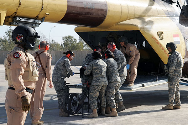 Members of the 332nd Expeditionary Medical Group unload a patient from an Iraqi helicopter during medical evacuation training for the Iraqi air force at Joint Base Balad, Iraq. (U.S. Air Force/Senior Airman Brittany Y. Bateman)