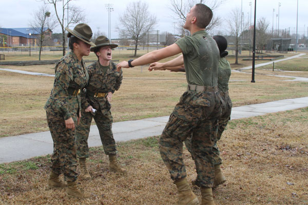 Two drill instructors with P Company, 4th Recruit Training Battalion, Marine Corps Recruit Depot Parris Island, S.C., yell at U.S. Marine Corps Pvt. Olivia K. Downing and U.S. Marine Corps Pfc. William A. Crouch. (Photo: Sgt. Dwight Henderson)