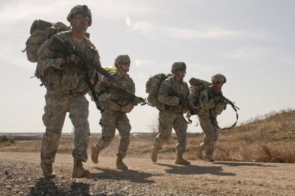 Soldiers from 3rd Cavalry Regiment run to the finish line of a four-mile road march held March 20 at Fort Hood. (U.S. Army Photo by Sgt. Samuel Northrup)