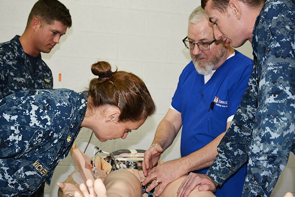 Mr. Scott McKee of Laerdal Medical, second from right, trains instructors on simulation equipment to be used in the Flight Medic Course (FMC) at the Naval Aerospace Medical Institution (NAMI). (U.S. Navy/HM2 Matthew Clutter)