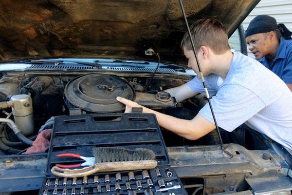 car repair: opening the hood