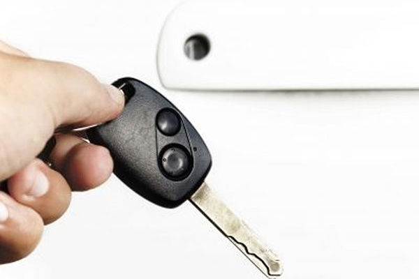 Key and a white car door.