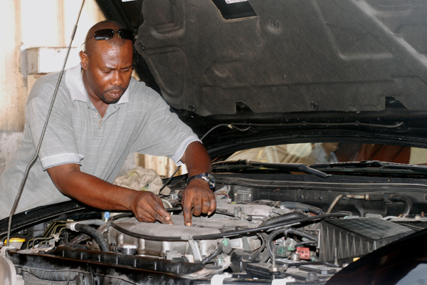 A man conducting engine maintenance.