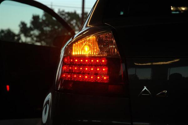 Left turn signal on a black car.