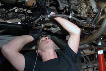 Man underneath engine repair.