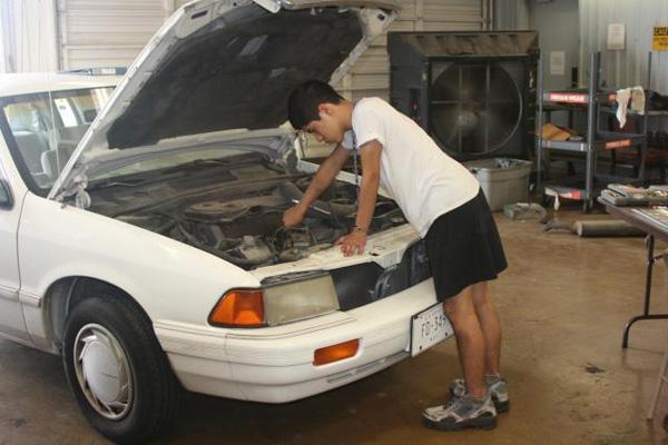 Engine repair in white car.