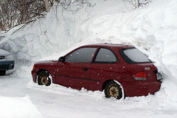 Car in snowbank.
