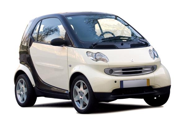 Small white smart car.