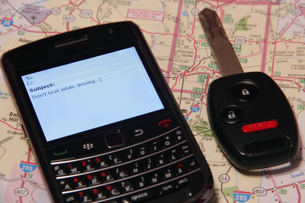 Cell phone and key on map.