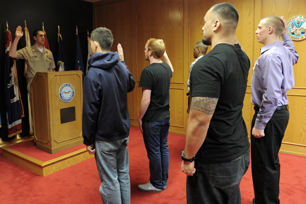 Military recruits take their oath.