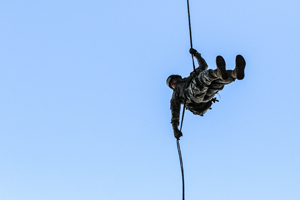 Sergeant 1st Class Greg Robinson rappelling