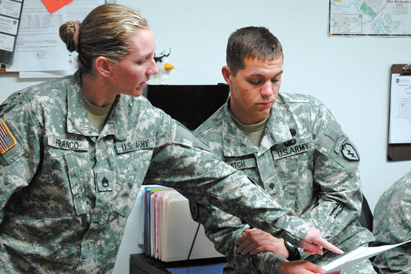 Army soldiers plan with a document.