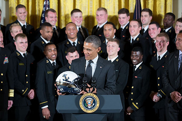 President Obama accepts a Naval Academy helmet in May as he greets the football team to the White House after the Navy football team won the 2012 Commander-in-Chief's Trophy.