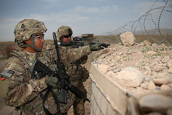 U.S. Army 1st Lt. Audrey Griffith, left, and Spc. Heidi Gerke, both with the 92nd Engineer Battalion, stand guard during a force protection exercise at Forward Operating Base Hadrian in Uruzgan province, Afghanistan, March 18, 2013. DoD courtesy photo
