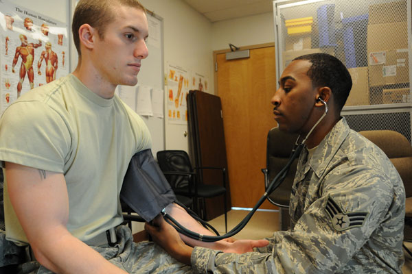 Ohio Air National Guard Senior Airman Bruce Moman, an Aerospace Medical Services Journeyman from the 180th Fighter Wing Medical Group, takes the blood pressure of a patient as part of an annual physical health assessment. U.S. Air Force photo