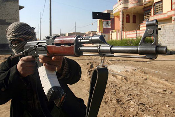 A gunman aims his weapon during clashes with Iraqi security forces in Fallujah, 40 miles (65 kilometers) west of Baghdad, Iraq, on Jan. 9, 2014.