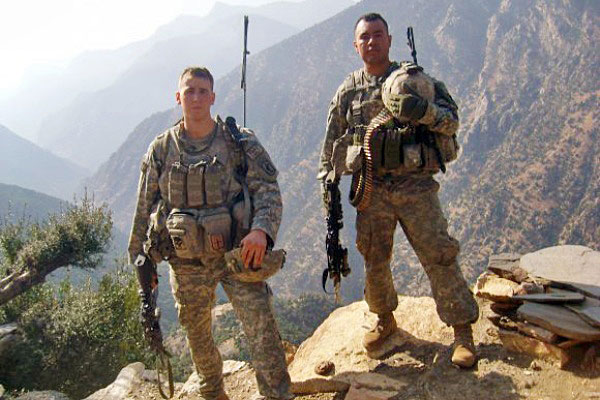 """Former Staff Sgt. Ryan M. Pitts, left, became the third living """"Sky Soldier"""" from the 173rd Airborne Brigade Combat Team to receive the Medal of Honor in the past four years."""