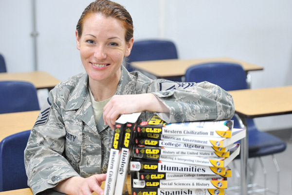 Airman with textbooks.