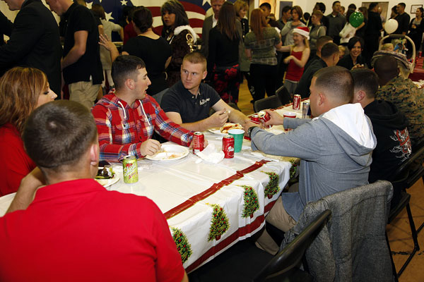 15th Marine Expeditionary Unit Command Element Marines enjoy a meal at the holiday party in 2011. Cpl. John Robbart III/Marine Corps