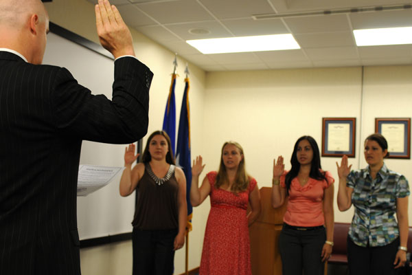 Four military spouses take the Oath of Allegiance during a naturalization ceremony in 2010. Staff Sgt. Nadine Y. Barclay/Air Force