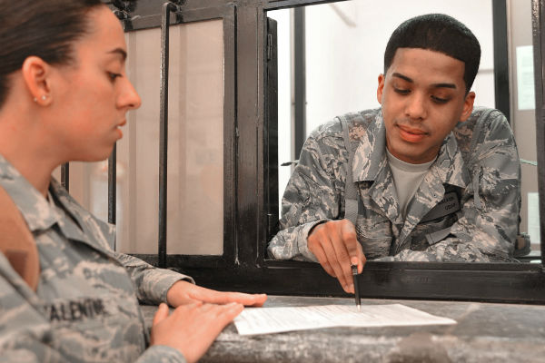 Airman helping service member with paperwork