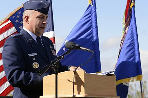 Col. Eugene Caughey speaks at a 9/11 commemoration in 2014 at Schriever Air Force Base, Colo. Air Force photo