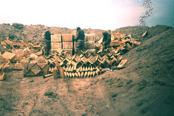 US soldiers prepare Iraqi munitions for demolition at the Tall al Lahm Ammunition Storage Depot South, March 1991. (DoD photo)
