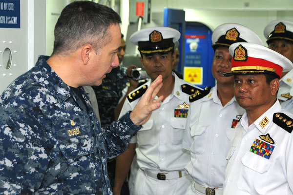 Capt. Daniel Dusek briefs Myanmar naval officers on board the USS Bonhomme Richard in 2012. (Navy/Mark R. Alvarez)