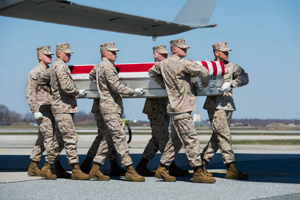 The remains of Marine Corps Staff Sgt. Louis F. Cardin of Temecula, Calif., arrive at Dover Air Force Base, Del., on March 21. (Air Force/Zachary Cacicia)