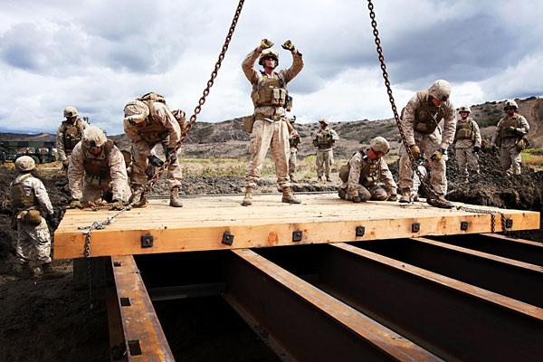 Marines building bridge