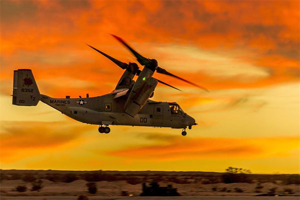 An MV-22 Osprey tiltrotor aircraft hovers over the desert. Nineteen men died when a Marine Corps Osprey crashed in Arizona on April 8, 2000. (DoD photo)