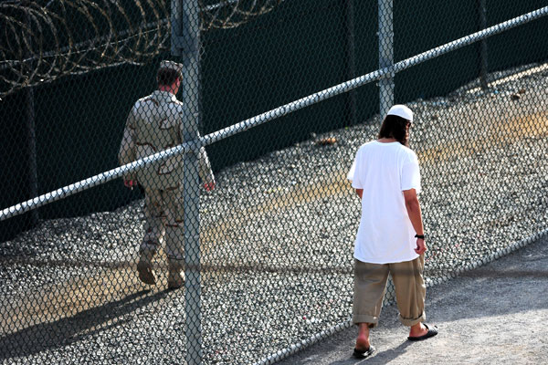 A guard and detainee inside the communal facility of Camp 6 at Joint Task Force Guantanamo. (DoD photo)