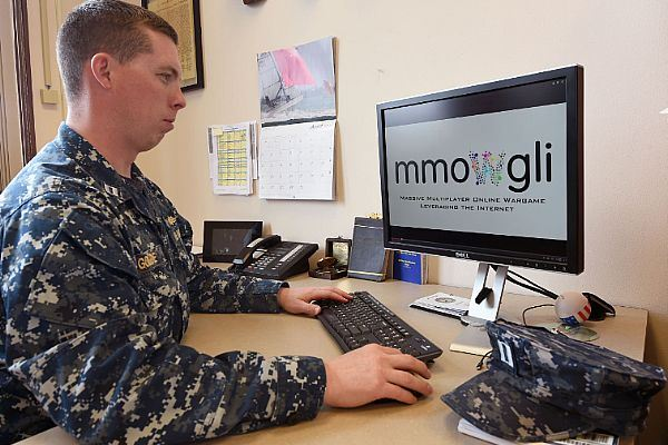 Lt. Daniel Golde, Naval Service Training Command training and readiness officer, checks out a new crowd-sourcing website developed by NSTC and the U.S. Naval Academy to get fleet feedback. (Photo by Scott Thornbloom/U.S. Navy)