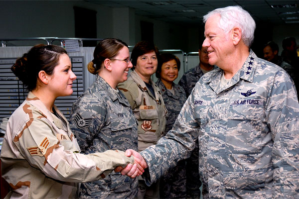 Gen. Arthur J. Lichte greets Air Force personnel at a Southwest Asia air base in January 2008. (US Air Force/Tia Schroeder)