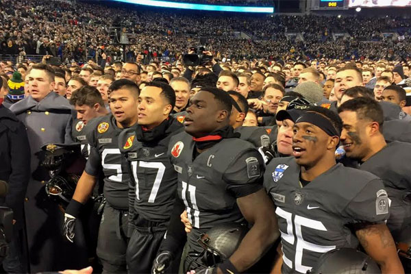 Army football players sing their alma mater after beating Navy for the first time in 15 years. (Military.com/Michael Hoffman)