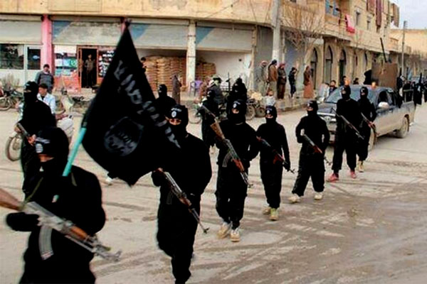 Islamic State terrorists march in Syria. (Courtesy Voice of America)