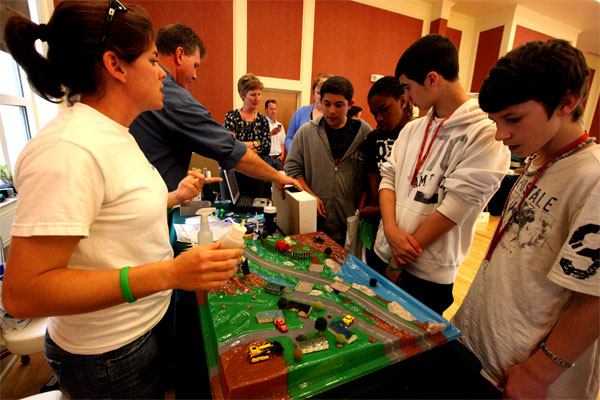 Alicia Filzen of Camp Lejeune's Environmental Management Division shows students how contaminants, trash and oils can seep into nearby lakes and rivers, during the Marine Corps base's Earth Day Expo on April 18, 2011. (Marine Corps photo/Victor Barrera)