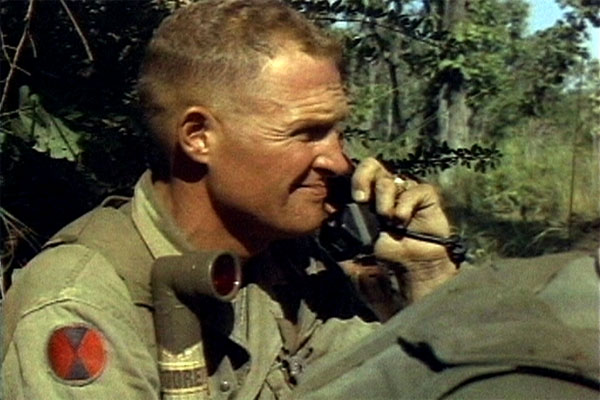 Lt. Col. Hal Moore talks on the radio during the fight for LZ X-Ray in the Ia Drang Valley of Vietnam, November 14-18, 1965. (US Army photo, taken from film footage)