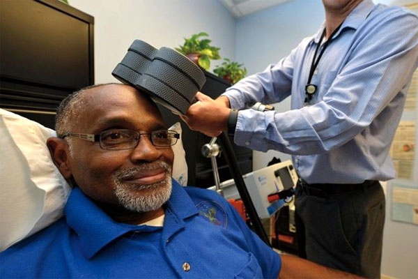 Percy Jones receives rTMS therapy to help treat his depression. (VA photo/James Arrowood)