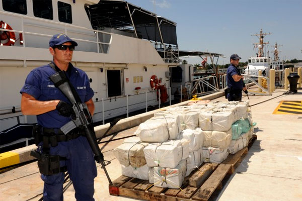 Coastguardsmen with captured contraband at Coast Guard Base Miami Beach in April 2013.(US Coast Guard photo/Sabrina Laberdesque)