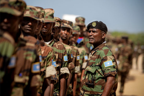 Somali soldiers march along under the watchful gaze of their NCO. A light infantry unit from the 101st Airborne Division is being sent to help train and equip Somalian troops in their fight against al-Shabab. (UN photo)