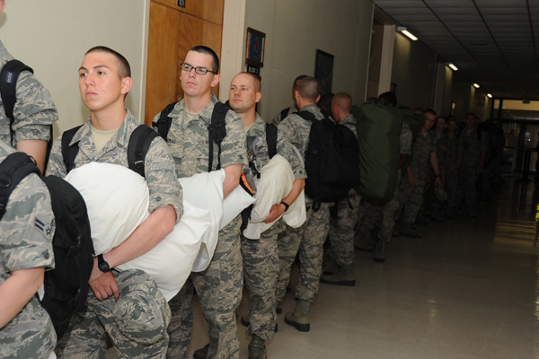 Air Force recruits holding pillows.