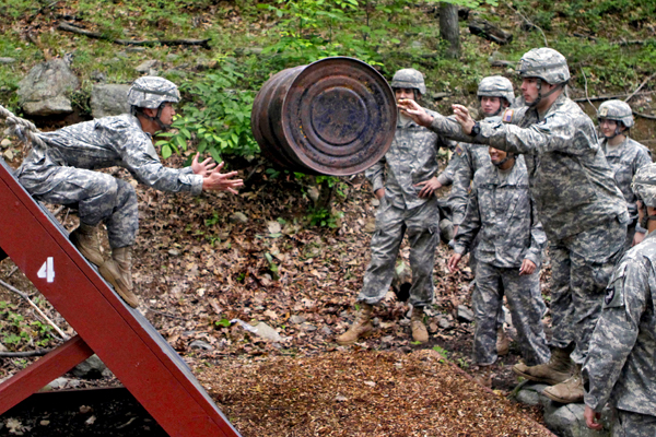 Basic training Army barrel throw.
