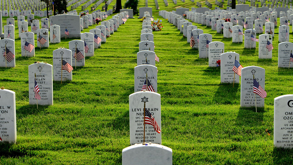Soldiers Plant Flags at Arlington Cemetery