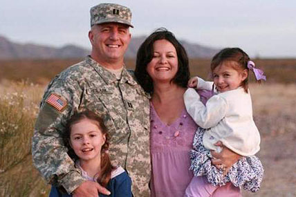 Capt. Bruce Kevin Clark is shown with his wife, Susan Orellana-Clark, and daughters Camille (left) and Catherine.
