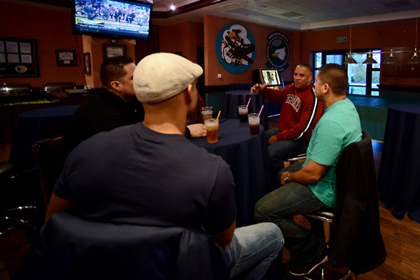 The Aviano's Integral Men group watches football and chats during their inaugural event, Nov. 15, 2014, at Aviano Air Base, Italy. AIM is a new group tailored to husbands of active-duty service members. Staff Sgt. R.J. Biermann/Air Force