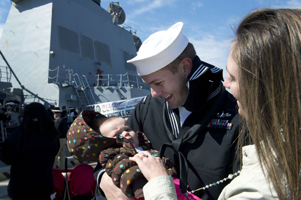 Construction Mechanic 2nd Class Jeff Reyes, assigned to the guided-missile destroyer USS Winston S. Churchill (DDG 81), meets his baby for the first time as the ship arrives in Norfolk in 2013. Mass Communication Specialist 3rd Class Sabrina Fine/Navy