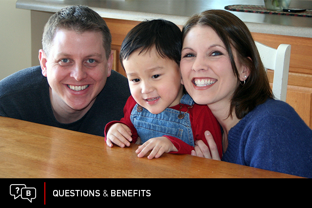 An Air Force couple smiles with their adopted son. (Photo: U.S. Air Force/Stacy Vaughn.)